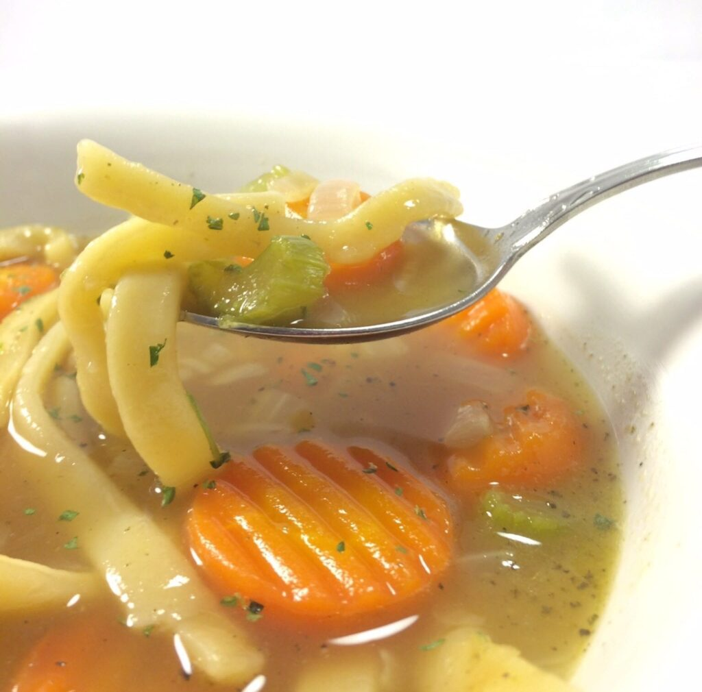 Enjoy a delicious bite of this turkey noodle soup.