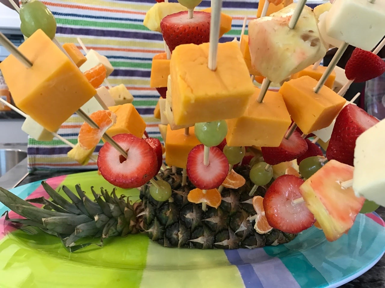 Fruit and cheese kebobs in a pineapple|The Holy Mess