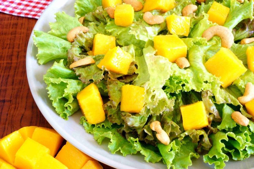 Mango Cashew Salad with chopped mango on table