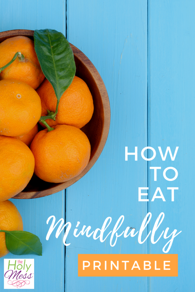 mindful eating, light blue wooden table with a bowl of oranges