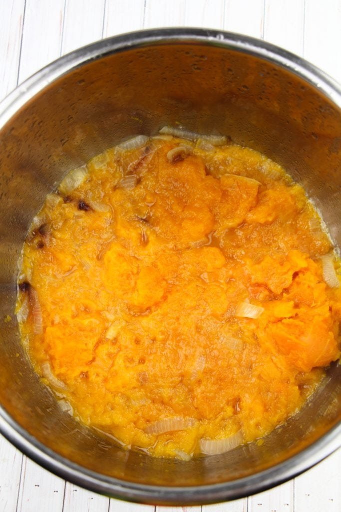 Cooking down squash for your Instant Pot butternut squash soup.