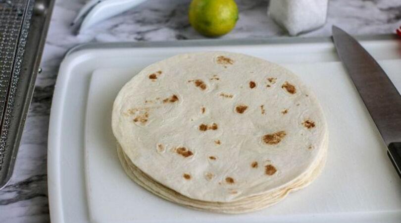 air fryer tortilla chips, tortillas on cutting board