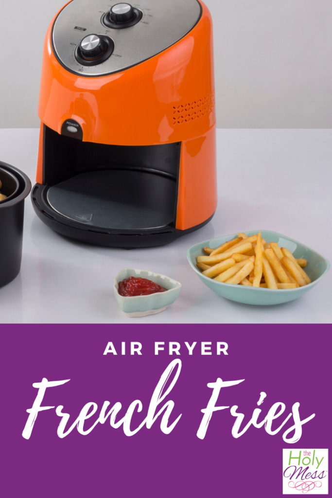 Orange air fryer with french fries