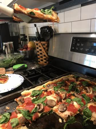 Homemade ww pizza with gooey cheese
