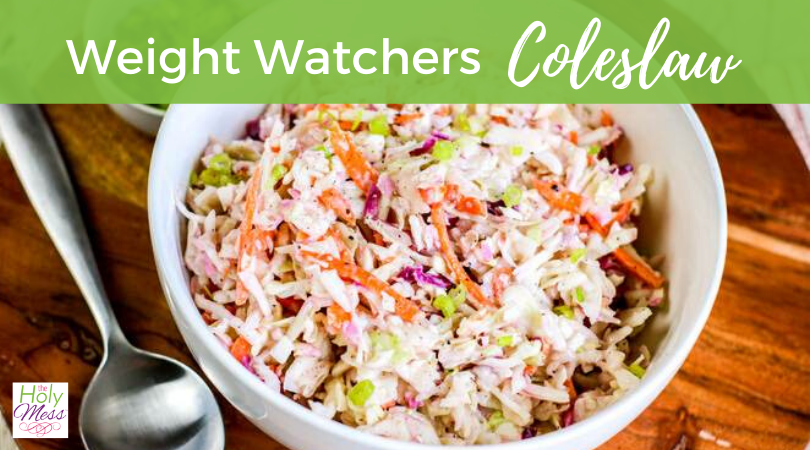 weight watchers coleslaw recipe, coleslaw in a white bowl, sitting on a wood table with a silver metal spoon
