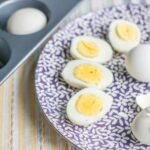 Baked hard boiled eggs on plate