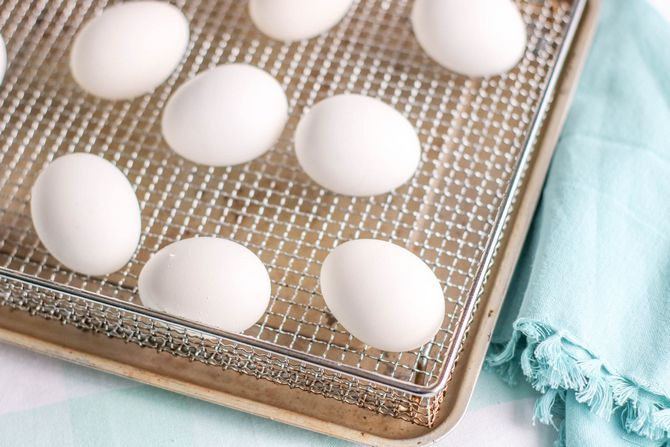 it's easy to make hard boiled eggs in the air fryer - eggs on fryer basket