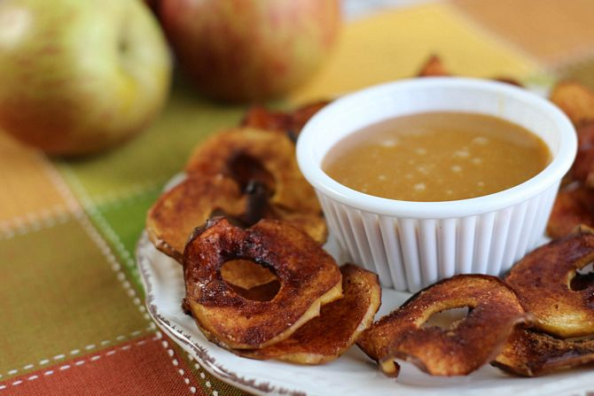 Air Fryer Apple Chips on plate with caramel dip