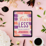Fear Less book on shelf with coffee